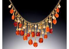 Judith Kaufman necklace: mandarin garnets, cultured pearls, 22ct and 18ct green gold; Matthew Feldman Gallery
