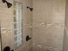 Walk-in shower with two shower heads; glass blocks in between