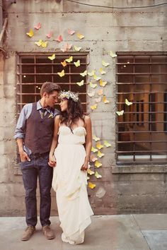 Butterflies decorate a wall -setting for wedding photos