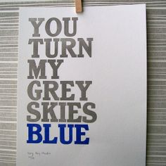 on the wall in a blue and grey baby boy nursery