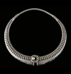 India | Torque necklace; hollow silver, decorated with granulation and floral motifs. Gujarat | A similar piece can be found in the Ghysels Collection; world of necklaces, page 276 | 400€ ~ Sold