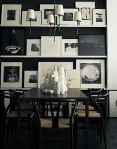 Love the black wall with all of the b&w; photographs.