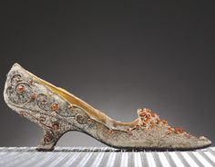 Woman's evening pump with silver thread embroidery and tulle topaz mounted on a nylon mesh. Designed by Roger Vivier, 1962. Belonged to Princess Soraya of Iran.