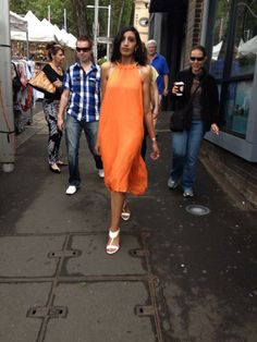 Aaliyah Aly wearing the latest Zlata Moda orange silk chiffon dress.