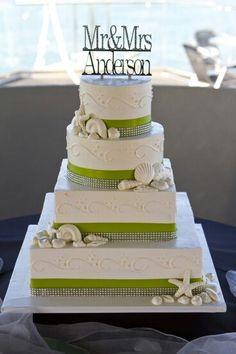 4 tier ivory wedding cake with square and round alternating tiers ...