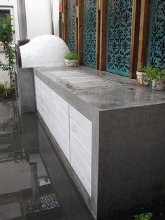Concrete bench. Screen. Pizza oven :)