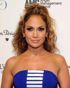A little chaos never hurt anyone! Channel your inner J. Lo by adding a little mousse to your locks for volume and texture, then pop the top half of your hair into a high ponytail. Click for more half-up half-down hairstyles for any and every hair type.