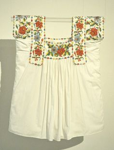 This pretty blouse was exhibited at the Museo Textil de Oaxaca in a show of textiles from the state of Oaxaca. Blouses like this one are worn on the coast of Oaxaca, but the beadwork is done in the state of Guerrero near Ometepec by Amuzgo and Mestiza women.