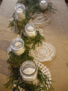 mason jars,doilies and burlap. Love this but I would add some red gingham bows to the jars. Christmas Tablescapes, Christmas Candles, Christmas Decorations, Table Decorations, Christmas Projects, Holiday Crafts, Holiday Decor, Burlap Centerpieces, Centrepieces
