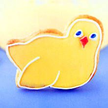 Easter Chicks gingerbread biscuits: For a special presentation, arrange the chicks in small boxes, baskets or other containers and surround them with shredded paper and chocolate mini eggs. These cute chicks make gifts or bright table decorations at birthday and christening parties too.