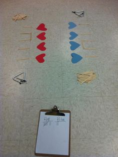 I dictate a rhythm, and a member of each team uses popsicle stick notation spell out that rhythm as quickly as possible. When they're finished, they ring their bell. The first team to accurately complete the rhythm gets a point. You're welcome.