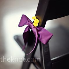 Purple satin bows and yellow button mums provided understated décor to the chairs lining the aisle.