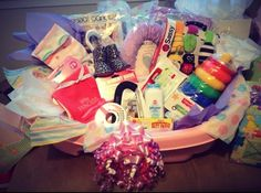 """A gift basket I put together for a friend! I filled her bath tub with some """"cute"""" items but mostly with things I loved having for Jude. Baby Tub Gift Basket, Baby Shower Baskets, Cheap Baby Shower Gifts, Diy Baby Gifts, Theme Baskets, Gift Baskets, Baby Boy Shower, Baby Showers, Baby Shower Themes"""