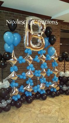 Star balloon wall. Letter b balloon. Black, silver and blue.