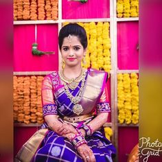 South Indian bride. Gold Indian bridal jewelry.Temple jewelry. Jhumkis.Purple silk kanchipuram sari with contrast purple blouse.Braid with fresh jasmine flowers. Tamil bride. Telugu bride. Kannada bride. Hindu bride. Malayalee bride.Kerala bride.South Indian wedding. Pinterest: @deepa8 Saree Wedding, Wedding Wear, Blouse Neck, Kerala Bride, Hindu Bride, South Indian Bride, South Indian Weddings, Purple Blouse, Indian Wedding Jewelry