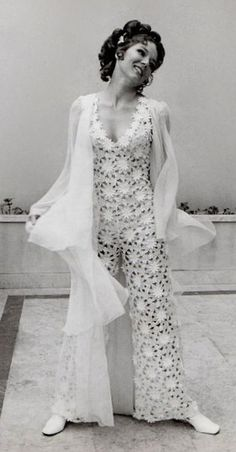 Diana Rigg wearing a lace jumpsuit 1969 white pantsuit crochet vintage fashion 60s 70s modern look