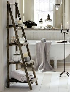 MY STYLE :: <3<3<3. Wish I had a bigger bathroom :( I love these ladder shelves that are so popular right now. Those glass jars by the window have gorgeous lids too! :: #bathroom #bathrooms