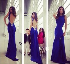 Get ready for the red carpet in this gorgeous royal blue mermaid maxi dress featuring a low back, floral design!