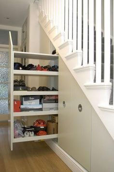 Pull out Storage Under Stairs. Tall broom cupboard with pull out under stairs storage. http://hative.com/clever-basement-storage-ideas/