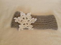 Check out this item in my Etsy shop https://www.etsy.com/listing/211283831/ready-to-ship-gray-adult-snowflake-ear