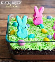 """Peeps Easter Bunny Dirt Cake — Have you ever made a dirt cake? They're always a hit at summertime picnics. For Easter, just add some green coconut """"grass"""", candy eggs, and a few Peeps (of course) for this darling Peeps Easter Bunny Dirt Cake from Food Family & Finds. #Easter #dessertrecipe #peeps #dirtcake"""