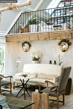 Lovely way to style a rustic modern open plan interior and make good use of a gallery area.
