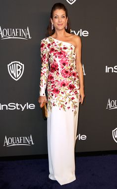 Flower power! Kate Walsh opts for a bright one-shoulder gown with a rosy floral print.