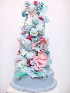 Cake by Nadia and Co. in Toronto, Ontario From the designer: This cake was designed to resemble the feather and fabric flowers on a Marchesa 2015 Spring gown that everyone was swooning over. With sugar paste blooms, I wanted to replicate the texture and composition of the way the florals laid at the back of the gown, almost as if they were dripping. Small, sparkly sugar beads and moulded leaf appliqués were used as accents.
