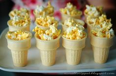 """Popcorn in cones as """"torches"""" for an Olympics party - so clever!"""
