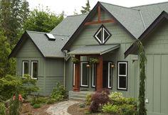 Extreme Exterior Paint Colors for Extreme People: Inspirational Dark Schemed Green Exterior Wall Painting For Traditional Home With A Frame Gables Combined With Wood Accents Of Pillars Geometrical Shape