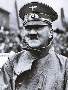 Adolf Hitler during one of his innumerable drives through Germany in the immediate pre-war years. A car addict, Hitler preferred his open-top, heavy duty Mercedes monster motorcar to any other vehicle. He was rarely fazed by rain and always wore his rain leathers just in case. This photo was taken in 1938 during a visit to the Sudetenland already incorporated into the Reich.