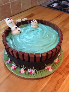 Olaf and friend in the hot tub drinking cocoa- birthday cake for Wray