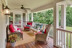 This front porch has Ipé decking and painted bead board ceilings