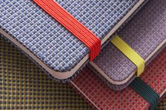 Blend Collection - Jacquard fabric covered notebooks with colored elastic closures and bookmark ribbons in accented colors