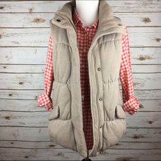 """[GAP] Soft & Cozy Tan Puffer Vest Large The perfect cozy vest for fall. Nice and puffy with a soft fleece lining. 2 front pockets. Zip front with snap overlay. High neck. Adjustable bungee at hem.  Color: Tan Fabric: 85% Cotton 15% Polyester (Poly Fill) Size: Large Bust: 19"""" Length: 26"""" Condition: EUC. No flaws.  No Trades! No PayPal! GAP Jackets & Coats Vests"""