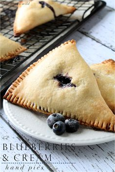 Blueberries and Cream Hand Pies - these adorable mini pies are packed full of creamy blueberry filling and perfect for traveling! Try these for a fruity sweet treat after dinner! #pie #fruit #dessert
