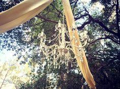 #outdoorwedding #chandelier #DIY #beautiful #wedding #springwedding #harmoniousevents #draping #ivory #white #crystals