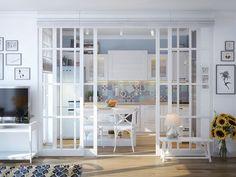 verrière intérieur en bois peint blanc à 2 vantaux coulissants vers la cuisine