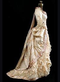 1880 was a decade of severely tight and restrictive corsetry that was worn (or endured) under dresses with long boned bodices, tight sleeves and high necks.