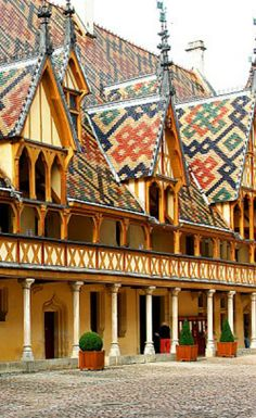 HOSPICE DE BEAUNE~ BURGUNDY, FRANCE. The multicolored tiled geometric patterned roofs of BEAUNE are beautiful. A lovely town in the great wine region of Burgundy. Of course, the wine is spectacular!