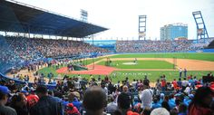 People wait for the start of a baseball exhibition game between Cuba and the Tampa Bay Rays at the Latinoamericano Stadium in Havana, to be attended by Obama and his family on Tuesday.  (Getty)