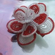 This hair clip is made of white and red seed beads using the french beaded flower technique.