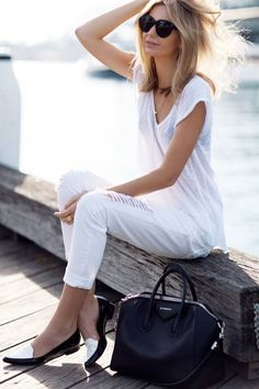 classy white outfit with white and black loafers.