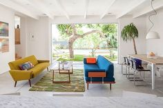 A pretty living area with some MCM pieces photographed by Michael Wells. Click on the image if you like mid-century modern furniture.