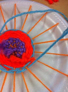 Paper Plate Looms~  Low-tech solution that makes weaving accessible to everyone.  Great art or craft project!