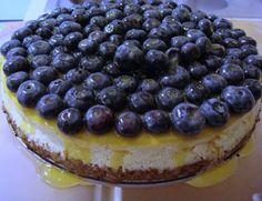 Cheesecake with Fresh Blueberries and Clementine Syrup
