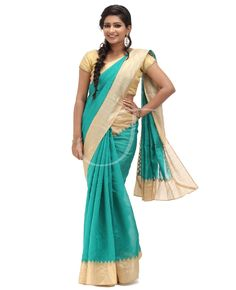 Bhagalpuri Fabric. Body is peacock green color with border. Golden chikoo color border. Pallu is bhagalpuri peacock green color with saree border. Blouse is golden chikoo color with attached peacock green color small border.