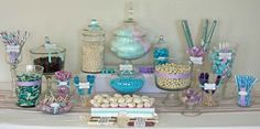 blue purple and white candy buffet 1024x508 How to Create a Candy Buffet- I like the use of covered boxes to give added height. circular/hat boxes also work nicely (perhaps decoupaged cardboard boxes from the craft store).