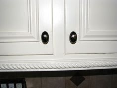 add trim to dress up kitchen cabinet doors