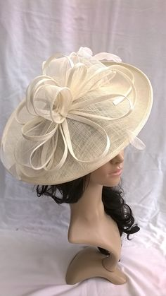 Ivory hatinator..Stunning Sinamay Hat on a Headband..Hatinator by SpecialDayfascinator on Etsy https://www.etsy.com/listing/270535681/ivory-hatinatorstunning-sinamay-hat-on-a